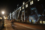 Amsterdam Light Festival is a winter light festival in the historical center of Amsterdam, a unique décor for this international light and water festival.<br /> <br /> Corresponding to the theme, 'Building with Light', 30 light sculptures and projections by international artists have been selected for this second edition. <br /> <br /> On trhe photo:  Reflections by Teresa Mar on the Hermitage Amsterdam