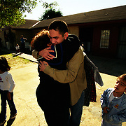 11/15/02<br />Grandma has a big hug for her grandson.