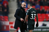 Pep Guardiola, the Manchester city manager speaks to Gabriel Jesus of Manchester City. Premier league match, Stoke City v Manchester City at the Bet365 Stadium in Stoke on Trent, Staffs on Monday12th March 2018.<br /> pic by Andrew Orchard, Andrew Orchard sports photography.