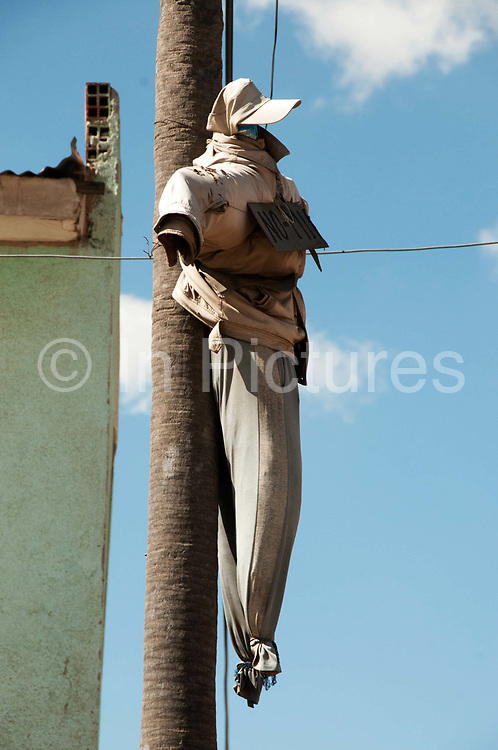Bolivia June 2013. El Alto. Dummies strung up on the street to warn thieves that the community will not tolerate them.