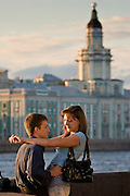 Saint Petersburg, Russia, 23/07/2005..Young lovers on Palace Quay by the River Neva.