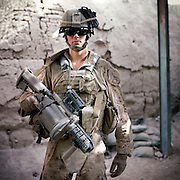 """Location:<br /> Patrol Base Fires, Sangin District, Helmand Province, Afghanistan<br /> <br /> Unit: <br /> 3rd Squad, 1st Platoon, Bravo Company, 1st Battalion, 5th Marines<br /> <br /> Name and Rank: Private First Class Scott McEtchin<br /> <br /> Age: 20<br /> <br /> Hometown: Pleasanton, California<br /> <br /> Interview selections:<br /> <br /> Why did you join the Marines?<br /> <br /> """"I joined the Marine Corps because I was kicked out of my house while I was going to college and ah, just started ah, being financially unstable. So I joined the Marine Corps basically so I could have a stable lifestyle I guess . . . And get away from home.""""<br /> <br /> Describe Sangin:<br /> <br /> """"When I pictured Afghanistan, it was mountains, and there's a lot of lush greenery everywhere, and I thought Afghanistan was just desert. And the people are very nice. They have very little and they're always willing to give you anything. They'll take you in their house, feed you, and for the most part they're really good people.""""<br /> <br /> """"They'll feed us, ah, anything from yogurt, which is pretty nasty cuz it's straight from their cows and goats. They'll feed us bread, it's like flatbread, kinda like a tortilla or a pita, that they make. It's called derday. And then they'll feed us rice or pilau.""""<br /> <br /> What do you think of the Taliban?<br /> <br /> """"I think the Taliban—as far as fighting us—is composed of younger people just looking for a  purpose in their life, 'cause in Afghanistan and the surrounding countries, you know Pakistan, Iran, a lot of the people are poor and have nothing, and they're looking for a way out and something that they can do with their life, so, America's here. They can fight America, they can get paid, they can be doing something other than farming land or selling goats at the bazaar, so, that's why I think they fight us.""""<br /> <br /> """"They probably don't like foreigners in their country, but for the most part I think they're just young kids l"""