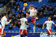 Barnsley's Marc Roberts (4) pulls down Cardiff City's Sean Morrison (blue shirt) in the box but no penalty is given by referee Tony Harrington (not in shot). EFL Skybet championship match, Cardiff city v Barnsley at the Cardiff city stadium in Cardiff, South Wales on Saturday 17th December 2016.<br /> pic by Carl Robertson, Andrew Orchard sports photography.