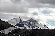 Sperry Glacier as viewed from Mount Clements is on the left side of the distant peak known as Gunsight Mountain, Glacier National Park, Montana, Tuesday, October 7, 2014. Sperry Glacier, one of the largest glaciers remaining in the park, is the glacier most studied by the USGS. Edwards Mountain is to the right of Gunsight.