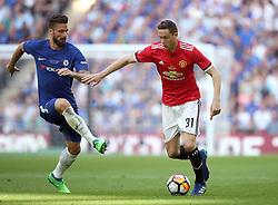 Chelsea's Olivier Giroud (left) and Manchester United's Nemanja Matic battle for the ball