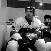 Two Minute Penalty…Ibrahim Oguz, (left) and Baris Sesli, Turkey...Expressions in the penalty box of players serving a two minute penalty during the 2012 IIHF Ice Hockey World Championships Division 3 contested by New Zealand, Iceland, Bulgaria, Turkey and China at Dunedin Ice Stadium. Dunedin, Otago, New Zealand. January 2012. Photo Tim Clayton