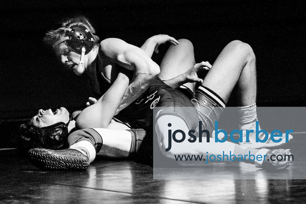 Aliso Niguel's Blake Runyon, Capistrano Valley's Joe Curry during Sea View league wrestling at Capistrano Valley High School on Thursday, January 14, 2016 in Mission Viejo, California. Capistrano Valley won 43-22. (Photo/Josh Barber)