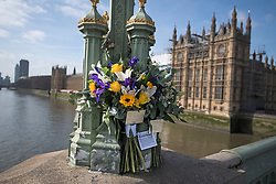 © Licensed to London News Pictures. 22/03/2018. London, UK. Floral Tributes left by family of the deceased at Westminster Bridge in London on the one year anniversary of the Westminster Bridge Terror attack in which lone terrorist killed 5 people and injured several more, in an attack using a car and a knife. The attacker, 52-year-old Briton Khalid Masood, managed to gain entry to the grounds of the Houses of Parliament and killed police officer Keith Palmer. Photo credit: Ben Cawthra/LNP