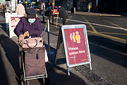 With most non-essential shops now closed and with retail sales suffering due to the Coronavirus pandemic, shoppers wearing face masks at Sainsburys supermarket out shopping on Kings Heath High Street on 31st December 2020 in Birmingham, United Kingdom. Small businesses have struggled through the Covid-19 pandemic and many have closed down altogether, while the big supermarkets have thrived, as the recession in the economy deepens and the crisis continues.