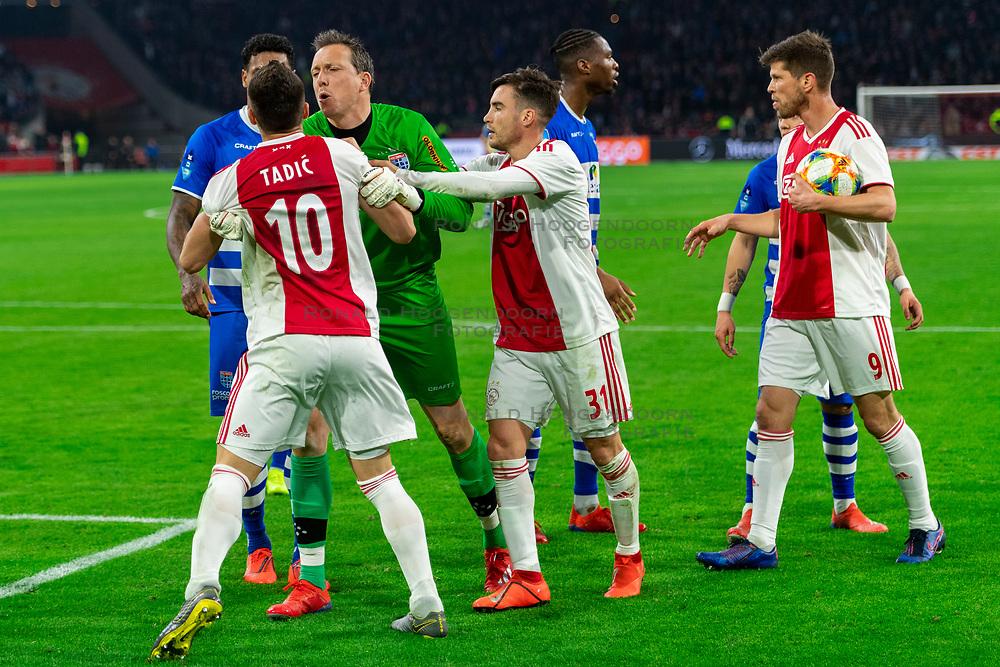 13-03-2019 NED: Ajax - PEC Zwolle, Amsterdam<br /> Ajax has booked an oppressive victory over PEC Zwolle without entertaining the public 2-1 / Darryl Lachman #29 of PEC Zwolle, Dusan Tadic #10 of Ajax, Diederik Boer #1 of PEC Zwolle, Nicolas Tagliafico #31 of Ajax, Gustavo Hamer #6 of PEC Zwolle, Klaas Jan Huntelaar #9 of Ajax