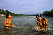 Machiguenga Indians Bathing<br />Timpia Community<br />Lower Urubamba River. Amazon Rain Forest<br />PERU.  South America