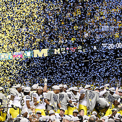 January 3, 2012; New Orleans, LA, USA; Michigan Wolverines players celebrate a win over the Virginia Tech Hokies in overtime as confetti falls following the Sugar Bowl at the Mercedes-Benz Superdome. Michigan defeated Virginia 23-20 in overtime. Mandatory Credit: Derick E. Hingle-US PRESSWIRE