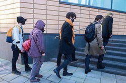 © Licensed to London News Pictures; 25/01/2021; Bristol, UK. Colston Four at court. JAKE SKUSE (left in light jacket) and SAGE WILLOUGHBY (middle in dark coat) arrive at Bristol magistrates court. Defendants Rhian Graham, 29, Milo Ponsford, 25, Jake Skuse, 32, and Sage Willoughby, 21, are due before Bristol Magistrates' Court for their first hearing today. They have been charged with criminal damage in connection with damage to the statue of slave trader Edward Colston which was pulled down during a Black Lives Matter protest on June 7 2020 and then thrown into Bristol Harbour. Police launched an appeal to trace suspects after the event and ten people were located. Six people accepted a caution while four were referred to the CPS. The statue was later retrieved by Bristol City Council who say that the damage is costed at £3,750. Police have warned anyone planning to protest at the court hearing that they will be breaking the lockdown laws which prohibit public gatherings of more than two people to combat the Covid-19 coronavirus pandemic. Photo credit: Simon Chapman/LNP.