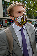 Robin Boardman one of the co-founder of XR UK, speaks to press outside Department for Transport after a group of Extinction Rebellion activists plted in red colour Department for Transport's main entrance in Horseferry Road, and glued themselves outside DPT in central London on Friday, Sept 4, 2020. There are other Extinction Rebellion protests ongoing in London. Environmental nonviolent activists group Extinction Rebellion enters its 4th day of continuous ten days protests to disrupt political institutions throughout peaceful actions swarming central London into a standoff, demanding that central government obeys and delivers Climate Emergency bill. (VXP Photo/ Vudi Xhymshiti)