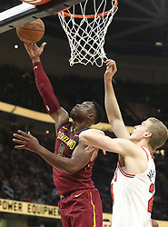 October 24, 2017 - Cleveland, OH, USA - The Cleveland Cavaliers' Dwyane Wade puts in two as the Chicago Bulls' Lauri Markkanen, right, defends during the second quarter on Tuesday, Oct. 24, 2017, at Quicken Loans Arena in Cleveland. (Credit Image: © Phil Masturzo/TNS via ZUMA Wire)