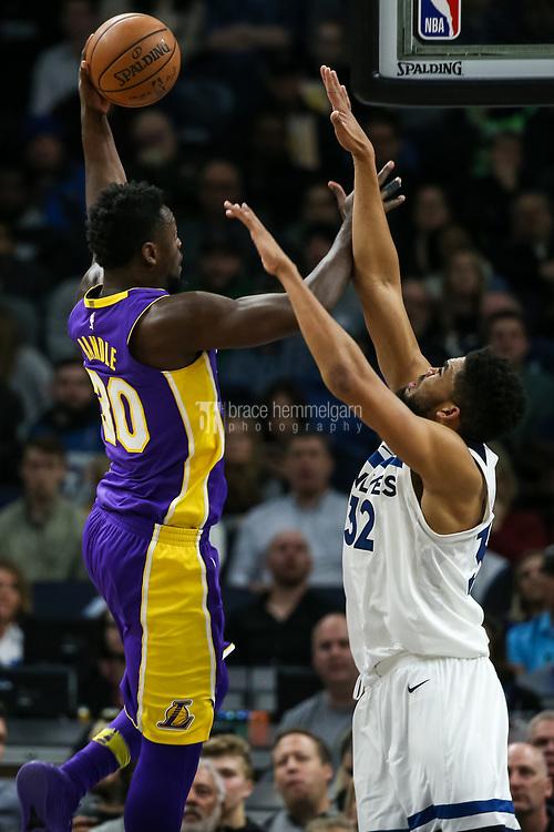 Feb 15, 2018; Minneapolis, MN, USA; Los Angeles Lakers forward Julius Randle (30) shoots over Minnesota Timberwolves center Karl-Anthony Towns (32) at Target Center. Mandatory Credit: Brace Hemmelgarn-USA TODAY Sports