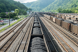 Trains carry coal from Williamson, West Virginia, where mountaintop mines are abundant. Mountaintop Removal is a method of surface mining that literally removes the tops of mountains to get to the coal seams beneath. It is the most profitable mining technique available because it is performed quickly, cheaply and comes with hefty economic benefits for the mining companies, most of which are located out of state. It is the most profitable mining technique available because it is performed quickly, cheaply and comes with hefty economic benefits for the mining companies, most of which are located out of state. Many argue that they have brought wage-paying jobs and modern amenities to Appalachia, but others say they have only demolished an estimated 1.4 million acres of forested hills, buried an estimated 2,000 miles of streams, poisoned drinking water, and wiped whole towns from the map. © Ami Vitale