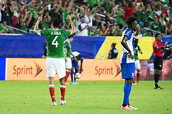July 20, 2017 - Glendale, Arizona, U.S - Mexico's HUGO AYALA (4) raise his arms after winning against Honduras Thursday, July 20, 2017, during the 2017 Gold Cup Quarterfinals at University of Phoenix Stadium in Glendale, Arizona.  Mexico won 1-0 against Honduras to advance to the 2017 Gold Cup Semifinals. (Credit Image: © Jeff Brown via ZUMA Wire)