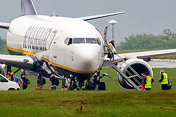 © Licensed to London News Pictures. 21/06/2020. Leeds UK. Passengers wearing face masks disembark Ryanair flight FR1221 from Alicante which landed this morning & is the first to arrive at Leeds for 12 weeks. The airport has been closed to the public since the UK government and other European nations introduced strict travel restrictions and lockdowns to try and curb the spread of the coronavirus in March.Photo credit: Andrew McCaren/LNP