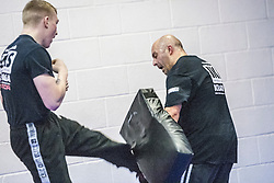 Students practising their kicking with pads. Stef Noij, KMG Instructor from the Institute Krav Maga Netherlands, takes the IKMS G Level Programme seminar today at the Scottish Martial Arts Centre, Alloa.