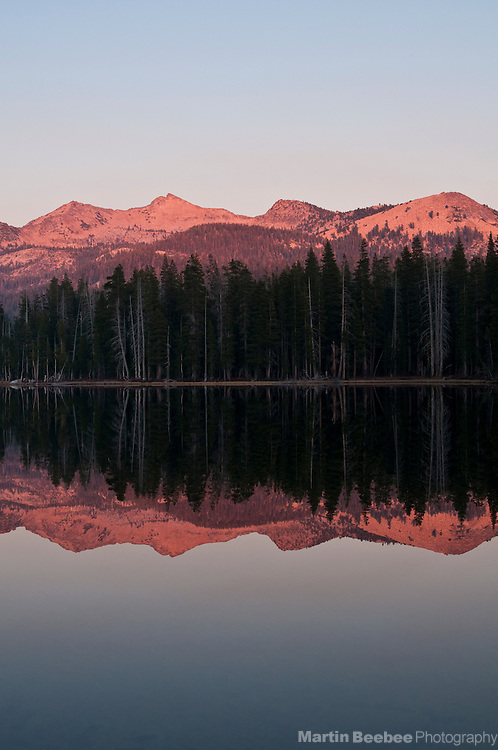 Alpenglow on The Crystal Range of the Sierra Nevada reflecting in Wright's Lake, Eldorado National Forest, California