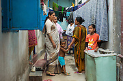 Nazma Akter (left) out visting garment workers in Dhaka, Bangladesh. <br /> <br /> Nazma is the President of Awaj Foundation. The Foundation was founded by Zazma in 2003 to support and empower garment workers to negotiate safer and fairer working conditions.