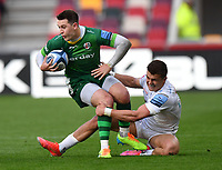 Rugby Union - 2020 / 2021 Gallagher Premiership - Round 19 - London Irish vs Exeter Chiefs - Brentford Community Stadium<br /> <br /> London Irish's Tom Parton is tackled by Exeter Chiefs' Henry Slade.<br /> <br /> COLORSPORT