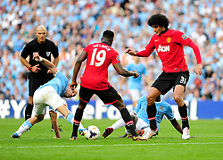 Manchester City's Pablo Zabaleta attempts to get the ball back - Photo mandatory by-line: Dougie Allward/JMP - Tel: Mobile: 07966 386802 22/09/2013 - SPORT - FOOTBALL - City of Manchester Stadium - Manchester - Manchester City V Manchester United - Barclays Premier League