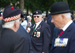 © Licensed to London News Pictures. 11/07/2013. London, UK. Les Thorington (C) a veteran of the Korean War is seen with comrades on Horse Guards Parade in London today (11/07/2013) as they prepare to march to Westminster Abbey. The parade and service held to commemorate the 60th Anniversary of the end of the Korean War, often known as the 'Forgotten War', which saw a United Nations force of many nations fight against North Korean and Chinese forces trying to invade South Korea. Photo credit: Matt Cetti-Roberts/LNP