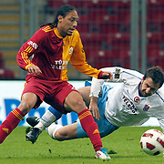 Galatasaray's Juan Pablo PINO (L) and Trabzonspor's Remzi Giray KACAR (R) during their Turkish superleague soccer derby match Galatasaray between Trabzonspor at the TT Arena in Istanbul Turkey on Sunday, 10 April 2011. Photo by TURKPIX