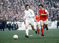 Peter Lorimer (Leeds) and Frank McLintock (Arsenal). Leeds United v Arsenal, 25/3/72. Credit: Colorsport.