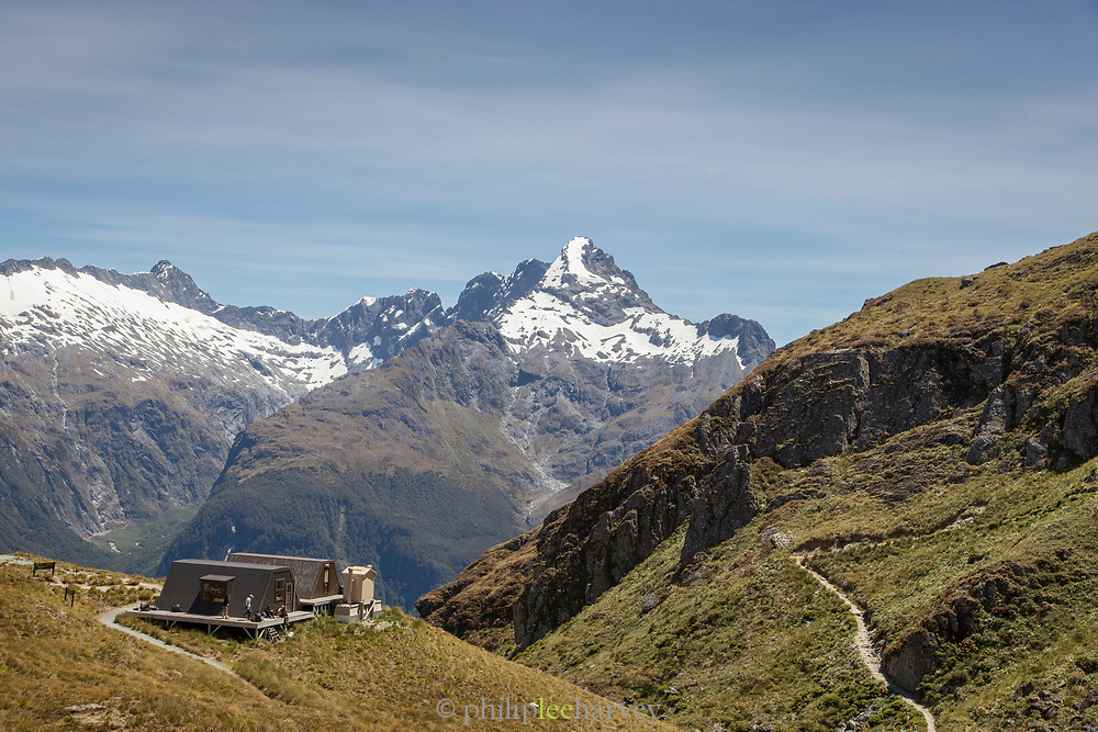 Landscape with snowcapped mountains and the Harris Saddle Shelter, Routeburn Track, South Island, New Zealand