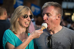 "© Licensed to London News Pictures . 04/07/2015 . Manchester , UK . A couple share an ice cream in the sunshine at the Castlefield Bowl as part of the "" Summer in the City "" festival in Manchester. Photo credit : Joel Goodman/LNP"