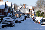Winter street scene in the snow in Moseley on 25th January 2021 in Birmingham, United Kingdom. Deep snow arrived in the Midlands giving some light relief and fun during the current lockdown for people who simply enjoyed the weather.