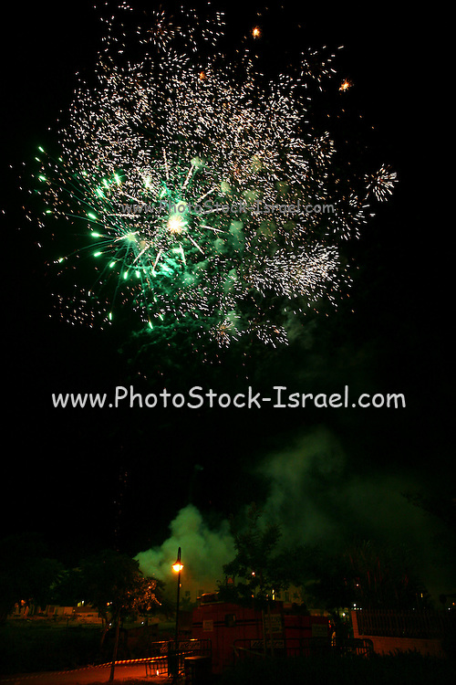 Fireworks at the celebrations for the 60th Independence birthday anniversary of Israel. On May 7, 2008. ..60; anniversary; celebration; demonstration; fireworks; independence; israel; Israel; Israeli; Independence; day; celebration; 60th; child; children; youth; teens; teenagers; teenager; spray; spraying; foam; soap; obnoxious; kid; kids; party; partying; psi; chenl