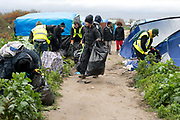 France. Refugees. Calais. So-called Jungle camp . Volunteers from Britain help clear up rubbish