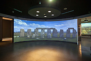 Details of the audio visual projection in the new Visitors Centre at Stonehenge, Wiltshire, UK. Stonehenge is a prehistoric monument and one of the most famous sites in the world. Stonehenge is the remains of a ring of standing stones set within earthworks. It is in the middle of the most dense complex of Neolithic and Bronze Age monuments in England, including several hundred burial mounds. Archaeologists believe it was built anywhere from 3000 BC to 2000 BC.