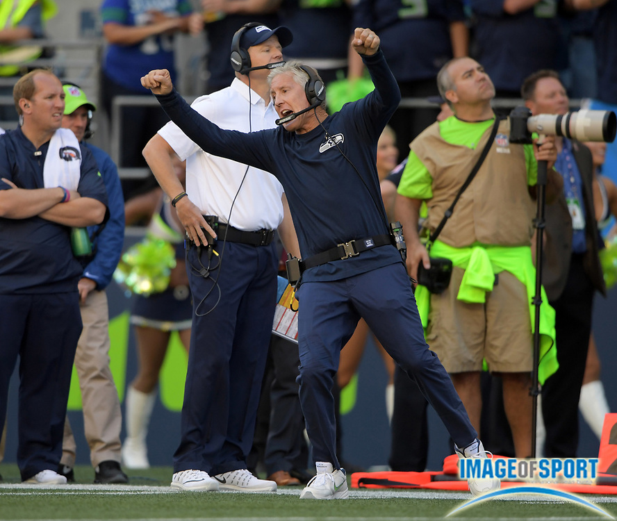 Sep 11, 2016; Seattle, WA, USA; Seattle Seahawks head coach Pete Carroll celebrates after a Seahawks touchdown with 31 seconds to play during a NFL game against the Miami Dolphins at CenturyLink Field. The Seahawks defeated the Dolphins 12-10.