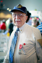 06 June 2014. The National WWII Museum, New Orleans, Lousiana. <br /> Unid'd WW2 veteran is honored with the French Legion of Honor medal.<br /> Photo; Charlie Varley/varleypix.com