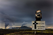 Crashed car used in  road safety campagn in  South Iceland. In the background is a 3,000 h.p. thermal generator power farm near the town of Hafnafjordur, the steam is visible for miles.