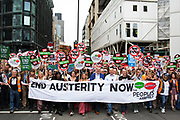 London, UK. Saturday 20th June 2015. People's Assembly against austerity demonstration through Central London. 250,000 people gathered to protest in a march through the capital protesting against the Tory cuts, holding placards and banners.