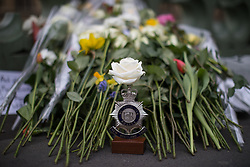 © Licensed to London News Pictures . 29/03/2017 . London , UK . A single white rose on top of a Metropolitan Police New Scotland Yard badge , left in tribute to PC Keith Palmer , on Westminster Bridge at the site of a memorial event commemorating the lives of those killed in Khalid Masood's terrorist attack in Westminster , that took place on 22nd March 2017 (one week ago) . Photo credit: Joel Goodman/LNP