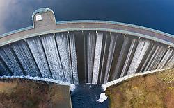 Glen Devon, Scotland, UK. 3 December 2020.  Aerial view of water from Castlehill reservoir  pouring over spillway on Castlehill Dam in Perth & Kinross. Iain Masterton/Alamy Live News