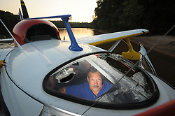 After a smooth seaplane landing on Lake Norman near the Highway 150 bridge Tello opens the front of the plane, steps out into the lake and pulls the plane up to the beach as if it were a boat. <br /> photo by Laura Mueller www.lauramuellerphotography.com