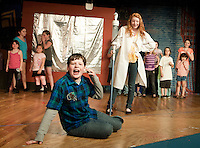 """Ryan Witham and Alexa Denbiac along with the Streetcar Kids Youth Theater perform """"Interjections"""" from Schoolhouse Rock during dress rehearsal Wednesday evening.  (Karen Bobotas/for the Laconia Daily Sun)"""