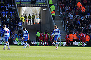 Reading's players inc Jem Karacan © show their dejection after Southampton players celebrate their 2nd goal. Barclays Premier league, Reading v Southampton at the Madejski stadium in Reading on Saturday 6th April 2013. pic by Andrew Orchard, Andrew Orchard sports photography,
