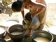 An Intha woman making tofu by hand, Kaung Daing village, Shan State, Myanmar. Located on the northwestern shore of Inle Lake, the Intha village of Kaung Daing is known for its tofu, prepared using split yellow peas instead of soybeans.