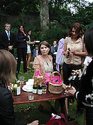 Sadie Frost. Afternoon tea party before the Frost French fashion show. Regents Park. 15 September 2002. © Copyright Photograph by Dafydd Jones 66 Stockwell Park Rd. London SW9 0DA Tel 020 7733 0108 www.dafjones.com