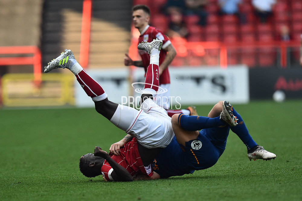 Angus MacDonald (50) of Hull City fouls Famara Diedhiou (9) of Bristol City during the EFL Sky Bet Championship match between Bristol City and Hull City at Ashton Gate, Bristol, England on 21 April 2018. Picture by Graham Hunt.
