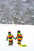 Love is.... photo of two little friends sledding on a snowy afternoon on Sled Hill in Woodstock,NY by Star Nigro.<br /> <br /> <br /> © 2021 All artwork is the property of STAR NIGRO.  Reproduction is strictly prohibited.